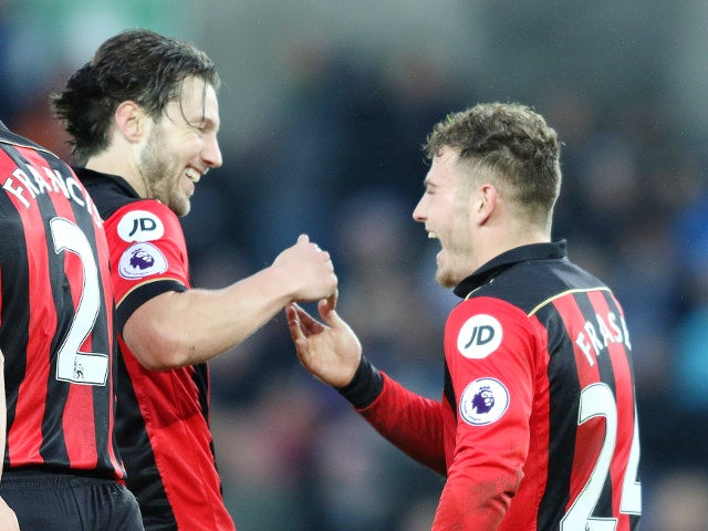 Bournemouth midfielder Ryan Fraser celebrates with teammate Harry Arter after scoring during his side's Premier League clash with Swansea City at the Liberty Stadium on December 31, 2016