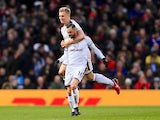 Steven Defour celebrates with Ben Mee after scoring during the Premier League game between Manchester United and Burnley on December 26, 2017