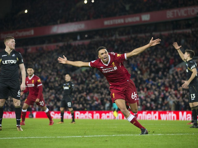 Trent Alexander-Arnold celebrates getting on the scoresheet during the Premier League game between Liverpool and Swansea City on December 26, 2017