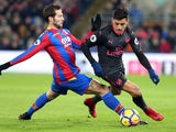 Yohan Cabaye and Alexis Sanchez in action during the Premier League game between Crystal Palace and Arsenal on December 28, 2017