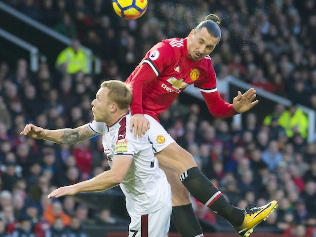 Zlatan Ibrahimovic tussles with Scott Arfield during the Premier League game between Manchester United and Burnley on December 26, 2017