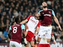 Andy Carroll and Claudio Yacob in action during the Premier League game between West Ham United and West Bromwich Albion on January 2, 2018