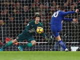 Eden Hazard scores from the spot past Petr Cech during the Premier League game between Arsenal and Chelsea on January 3, 2018