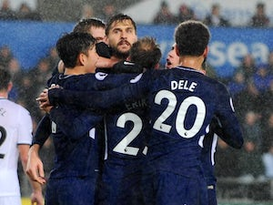 Result: Spurs edge past Swansea in wet Wales