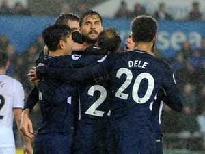 Result: Spurs edge past Swansea in wet Wales