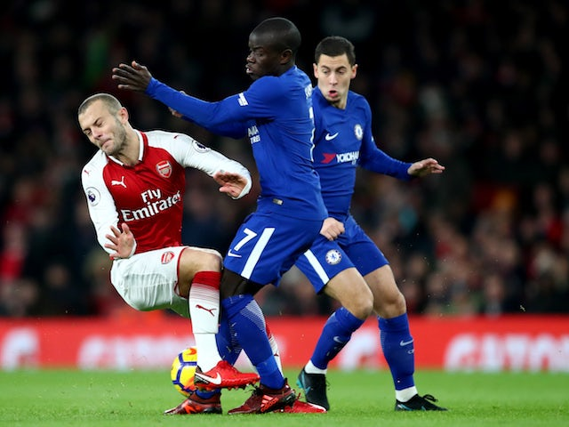Jack Wilshere, Eden Hazard and N'Golo Kante in action during the Premier League game between Arsenal and Chelsea on January 3, 2018