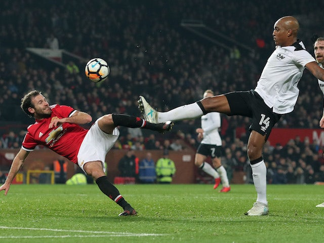 Juan Mata and Andre Wisdom in action during the FA Cup game between Manchester United and Derby County on January 5, 2018