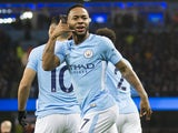 Raheem Sterling celebrates scoring during the Premier League game between Manchester City and Watford on January 2, 2018