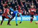 Alexandre Lacazette and Nathan Ake in action during the Premier League game between Bournemouth and Arsenal on January 14, 2018