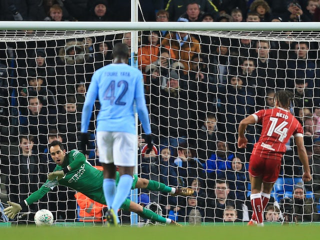 Bobby Reid scores from the spot during the EFL Cup game between Manchester City and Bristol City on January 9, 2018