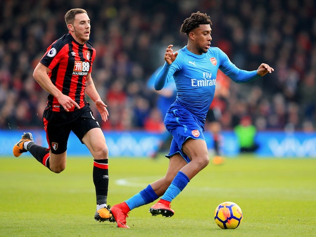 Dan Gosling and Alex Iwobi in action during the Premier League game between Bournemouth and Arsenal on January 14, 2018