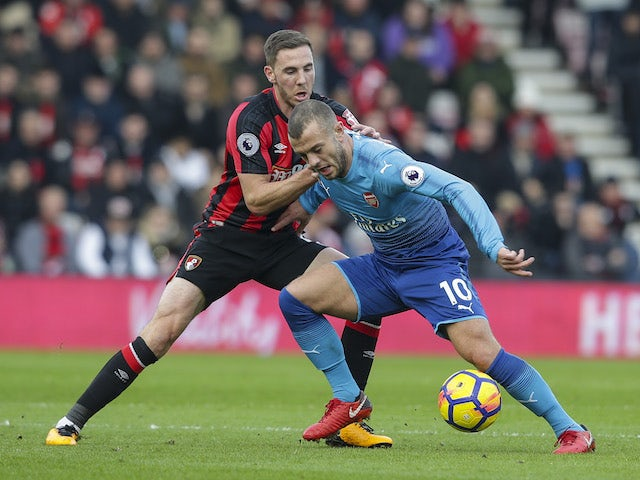 Dan Gosling and Jack Wilshere in action during the Premier League game between Bournemouth and Arsenal on January 14, 2018