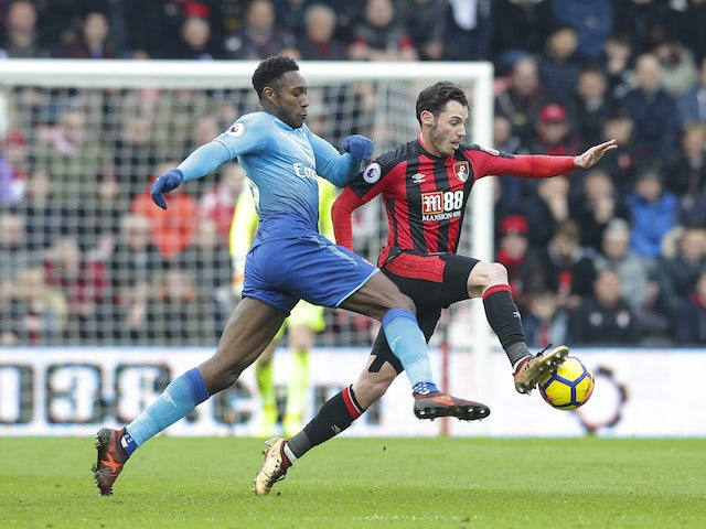 Danny Welbeck and Adam Smith in action during the Premier League game between Bournemouth and Arsenal on January 14, 2018
