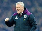 David Moyes celebrates during the Premier League game between Huddersfield Town and West Ham United on January 13, 2018