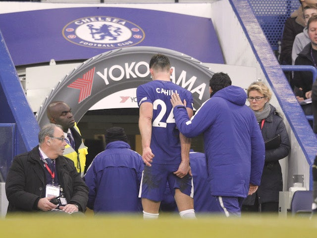 Gary Cahill is forced off with an apparent hamstring problem during the Premier League game between Chelsea and Leicester City on January 13, 2018