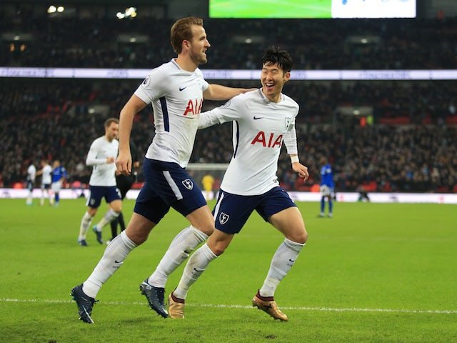 Harry Kane celebrates with Son Heung-min after scoring the second during the Premier League game between Tottenham Hotspur and Everton on January 13, 2018