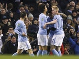 Kevin De Bruyne celebrates with teammates after scoring an equaliser during the EFL Cup game between Manchester City and Bristol City on January 9, 2018