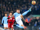 Nicolas Otamendi in acrobatic action during the Premier League game between Liverpool and Manchester City on January 14, 2018