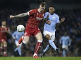 Raheem Sterling in action with Aden Flint during the EFL Cup game between Manchester City and Bristol City on January 9, 2018