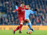 Roberto Firmino and Danilo in action during the Premier League game between Liverpool and Manchester City on January 14, 2018