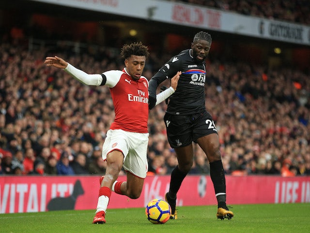 Alex Iwobi and Bakary Sako in action during the Premier League game between Arsenal and Crystal Palace on January 20, 2018