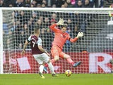 Asmir Begovic saves a shot from Marko Arnautovic during the Premier League game between West Ham United and Bournemouth on January 20, 2018