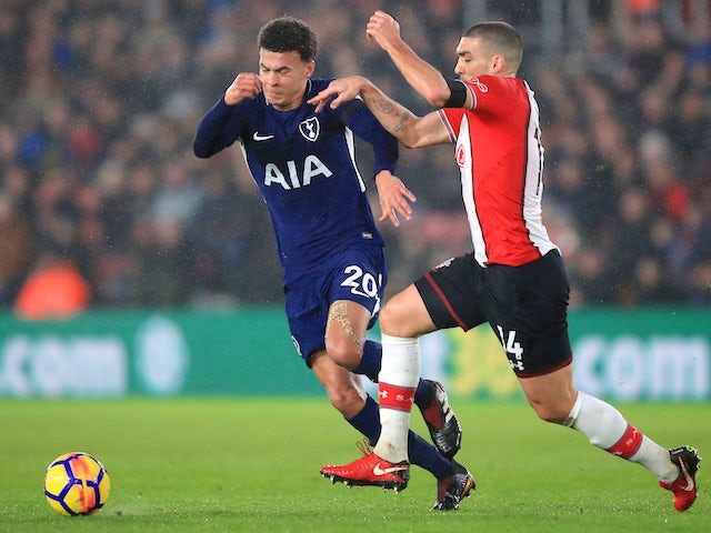 Dele Alli and Oriol Romeu in action during the Premier League game between Southampton and Tottenham Hotspur on January 21, 2018