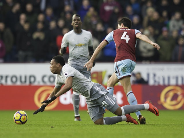 Jack Cork brings down Anthony Martial during the Premier League game between Burnley and Manchester United on January 20, 2018