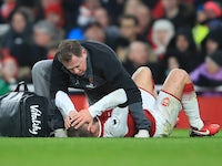 Jack Wilshere goes down with an injury to his head during the Premier League game between Arsenal and Crystal Palace on January 20, 2018