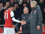 Mesut Ozil shakes Arsene Wenger's hand during the Premier League game between Arsenal and Crystal Palace on January 20, 2018