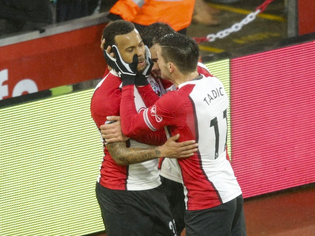Ryan Bertrand and Dusan Tadic celebrate the opener during the Premier League game between Southampton and Tottenham Hotspur on January 21, 2018