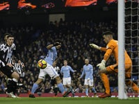 Sergio Aguero scores during the Premier League game between Manchester City and Newcastle United on January 20, 2018