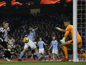 Aguero hat-trick downs Newcastle