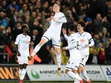 Alfie Mawson celebrates scoring during the Premier League game between Swansea City and Liverpool on January 22, 2018