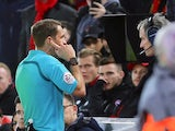 Referee Craig Pawson checks VAR during the FA Cup fourth round clash between Liverpool and West Bromwich Albion at Anfield on January 27, 2018