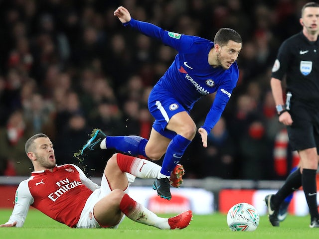 Jack Wilshere tackles Eden Hazard during the EFL Cup semi-final second leg between Arsenal and Chelsea at the Emirates Stadium on January 24, 2018