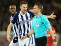 West Bromwich Albion defender Jonny Evans complains to referee Craig Pawson over a VAR decision during his side's FA Cup fourth round clash with Liverpool at Anfield on January 27, 2018