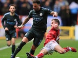 Kyle Walker and Joe Bryan in action during the EFL Cup game between Bristol City and Manchester City on January 23, 2018