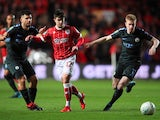 Liam Walsh, Sergio Aguero and Kevin De Bruyne in action during the EFL Cup game between Bristol City and Manchester City on January 23, 2018