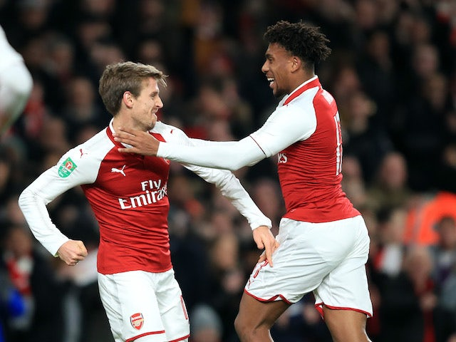 Arsenal pair Nacho Monreal and Alex Iwobi celebrate during their side's EFL Cup semi-final with Chelsea at the Emirates Stadium on January 24, 2018