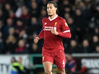 Virgil van Dijk in action during the Premier League game between Swansea City and Liverpool on January 22, 2018