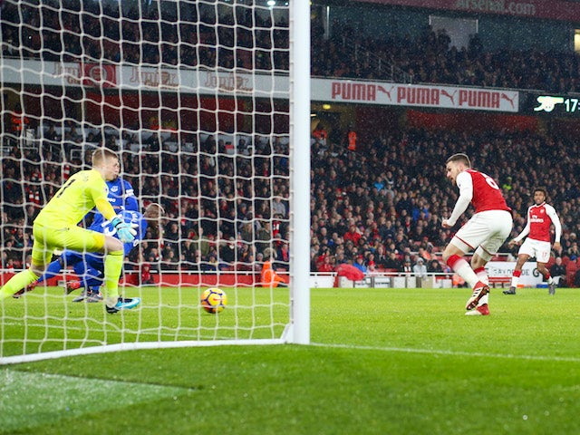 Aaron Ramsey scores the opener during the Premier League game between Arsenal and Everton on February 3, 2018