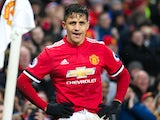 Alexis Sanchez of Manchester United prepares to take a corner during the Premier League match against Huddersfield Town on February 3, 2018