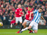 Alexis Sanchez and Tommy Smith during the Premier League match between Manchester United and Huddersfield Town on February 3, 2018