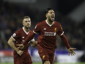 Liverpool coast to win over Huddersfield