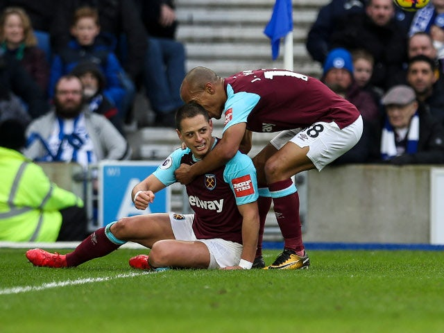 Javier Hernandez scores the equaliser during the Premier League match between Brighton & Hove Albion and West Ham United on February 3, 2018