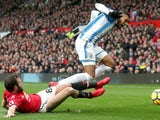 Juan Mata tackles Collin Quaner in the Premier League match between Manchester United and Huddersfield Town on February 3, 2018