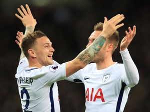 Kieran Trippier celebrates the second with Christian Eriksen during the Premier League game between Tottenham Hotspur and Manchester United on January 31, 2018