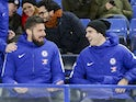 New teammates Olivier Giroud and Alvaro Morata sit side by side during the Premier League game between Chelsea and Bournemouth on January 31, 2018