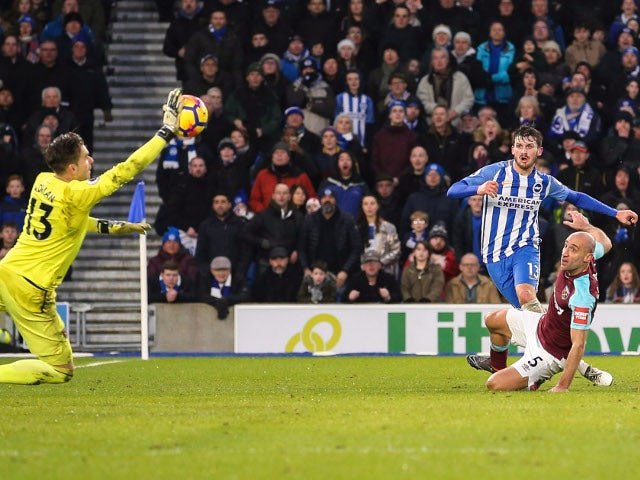 Adrian saves a shot from Pascal Gross during the Premier League match between Brighton & Hove Albion and West Ham United on February 3, 2018
